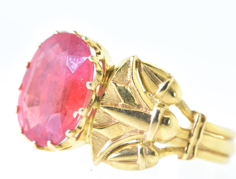 The bright vivid orange fire opal measures 11 by 8.7 mm.  It is held by 14 prongs in an 18K yellow gold highly sculptured ring of lotus flowers - a very Egyptian revival  motif.  This ring is a size 6 and can easily be sized.