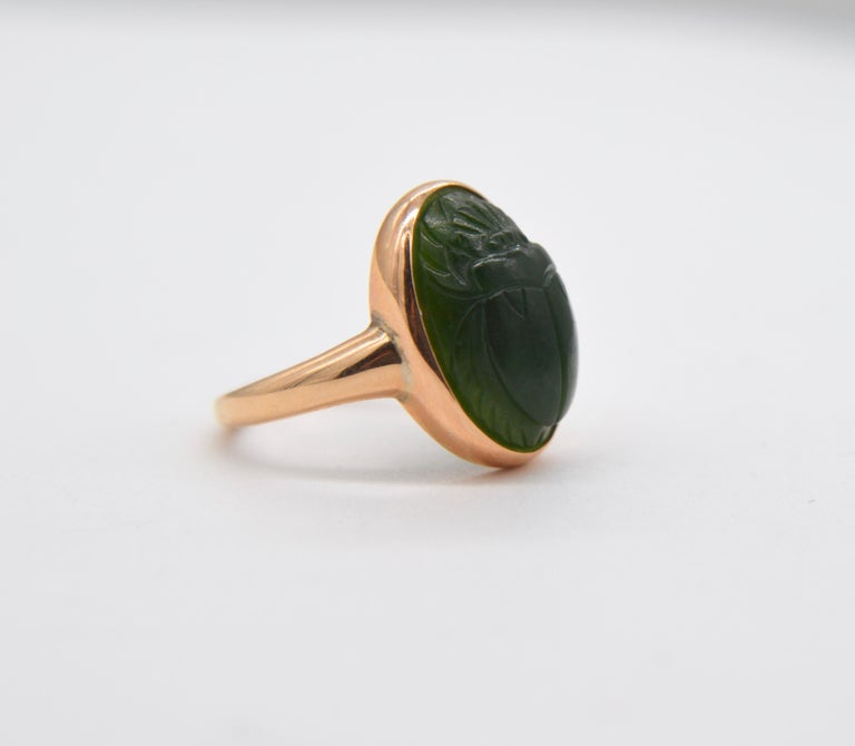 Gorgeous Egyptian revival carved scarab beetle jade antique Art Deco era circa 1920s 14K rose gold vintage ring. In very good condition. Stone measures 15x10mm (6 carats). Ring is unmarked, but acid tested as solid 14K gold. Size 4, can be resized