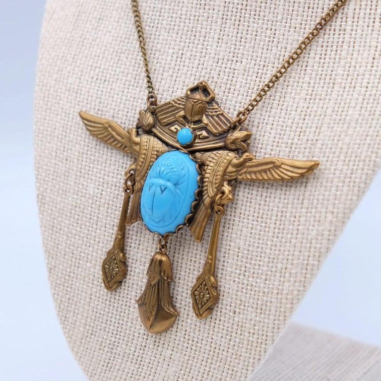 Year: 1930 Hallmark: EBE Dimensions: chain L 16 Inch, pendant H 3 Inch Materials: base metal, faux turquoise