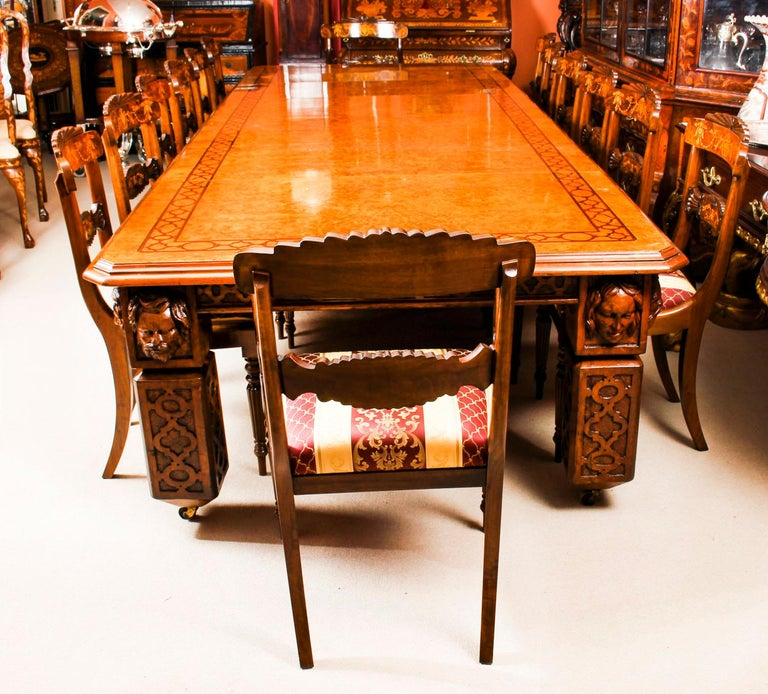 There is no mistaking the style and sophisticated design of this dining set comprising an exquisite rare English antique Elizabethan Revival pollard oak extending dining table, circa 1850 in date and a set of fourteen vintage dining chairs.  The