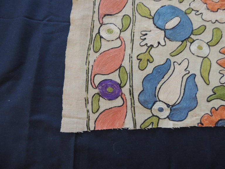 Antique embroidered floral silk Suzani textile fragment. In shades of orange, natural, blue, red, yellow and green. Ideal to make a pillow. Size: 16
