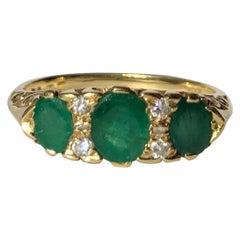Antique Emerald and Diamond 18 Carat Gold Three-Stone Ring