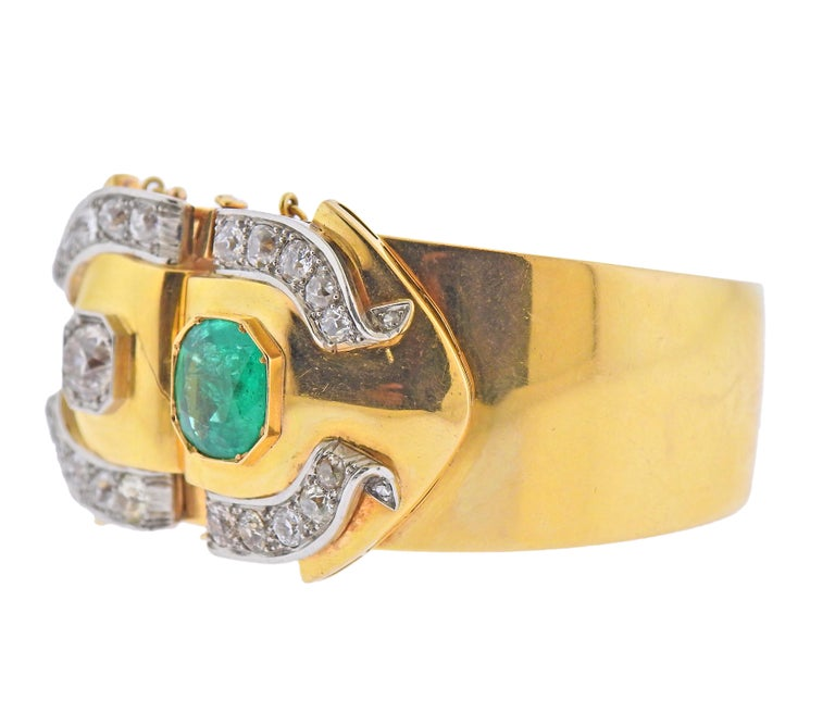 Antique 18k gold bangle bracelet, adorned with approx.  ( 5.50-6.00ctw in old mine cut diamonds ( approx. 1.25ct center diamond) and 11mm x 10.3mm emerald. Bracelet will fit up to 7
