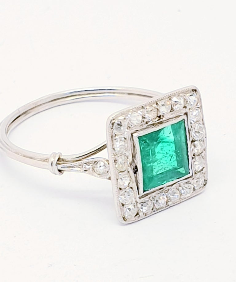 Offering an Emerald Diamond Belle Époque plaque ring. It is French origin. It is platinum the French hallmark shows on the thin wire style band. The center part is set with 20 x 0.03ct diamonds Total weight :0.60ct  The emerald is around 1ct . The