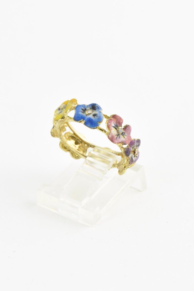 Victorian hand-painted enamel pansy ring with diamond centers and 14K yellow gold band. US size 5.5; cannot be sized. Enamel is fragile and can chip; keep away from chemicals. Age wear.