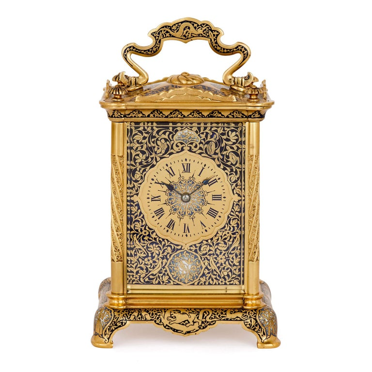 The contrast between rich blue enamel, in light and dark hues, and bright gilt bronze gives this carriage clock a sumptuous, luxurious feel. With a timeless design, the clock could be used within a traditional or modern design scheme. Equally it