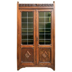 English Carved Oak Bookcase Green Leaded Glass Jacobean Style, 20th Century