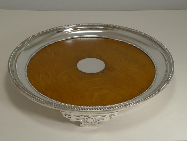 A rare circular oak and silver plated tray, unusual, you just don't come across circular examples and early examples like this.  The underside is lucky enough to have an English design registration lozenge which we can date to 17th October