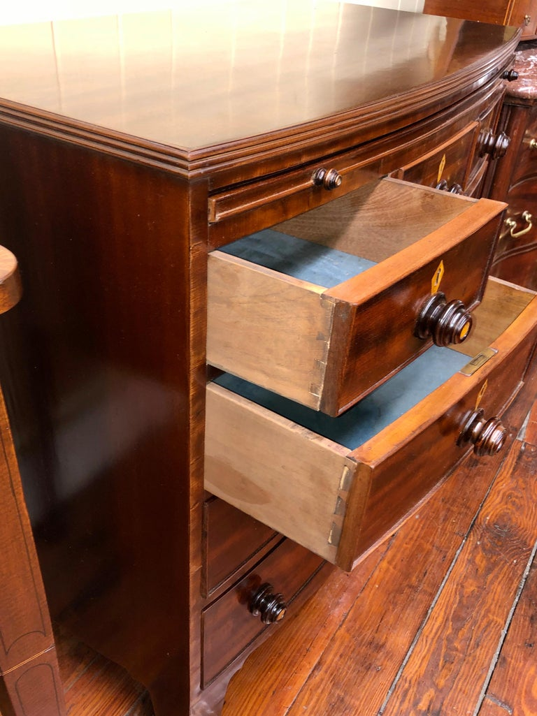Antique English Figured Mahogany Bowfront Chest with Brushing Slide For Sale 4
