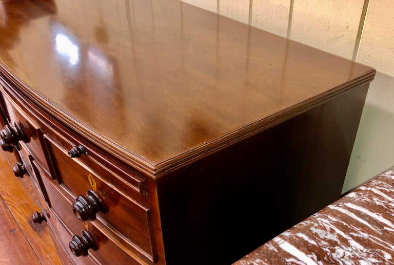 Hand-Crafted Antique English Figured Mahogany Bowfront Chest with Brushing Slide For Sale
