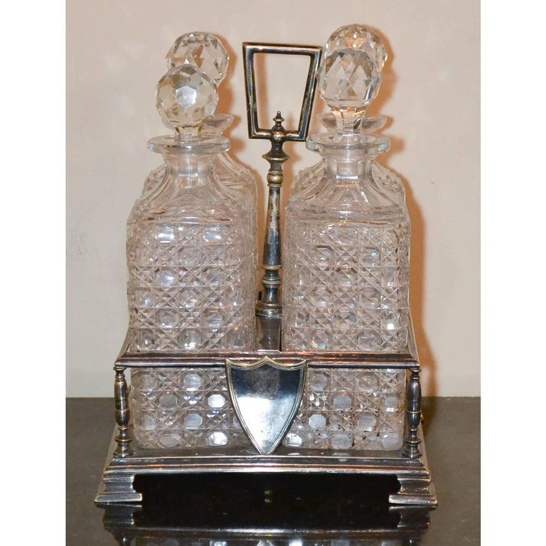Antique English Four Bottle Tantalus, circa 1890 In Good Condition For Sale In Dallas, TX
