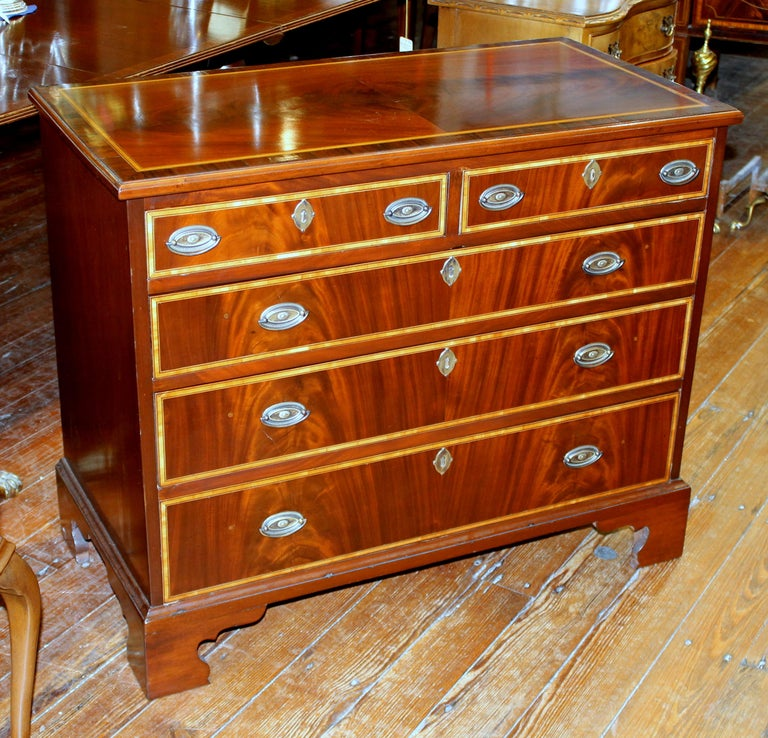 Fabulous quality antique English George III inlaid flame mahogany rare diminutive size low chest of drawers with magnificent book-matched crotch mahogany. Even the top is beautifully book-matched quartered and veneered flame mahogany.  Please note