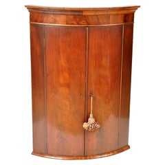 Antique English Georgian Flame Mahogany Bow-Fronted Corner Cabinet, circa 1780