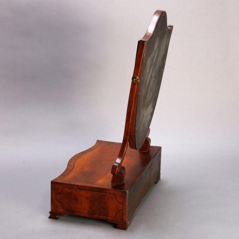 Inlay Antique English Georgian Flame Mahogany Shield Form Shaving Mirror, circa 1810 For Sale