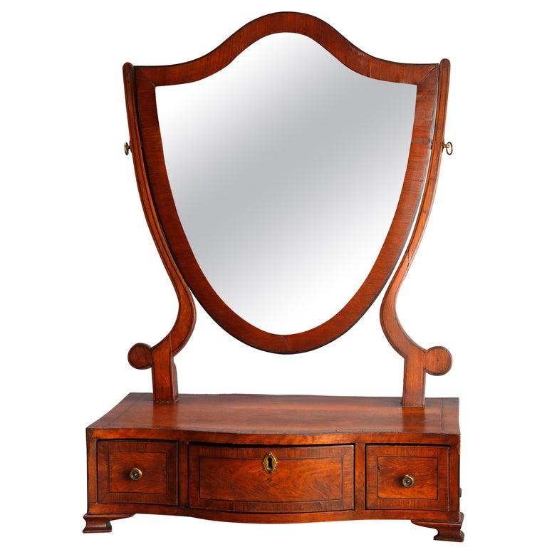 Antique English Georgian Flame Mahogany Shield Form Shaving Mirror, circa 1810 For Sale