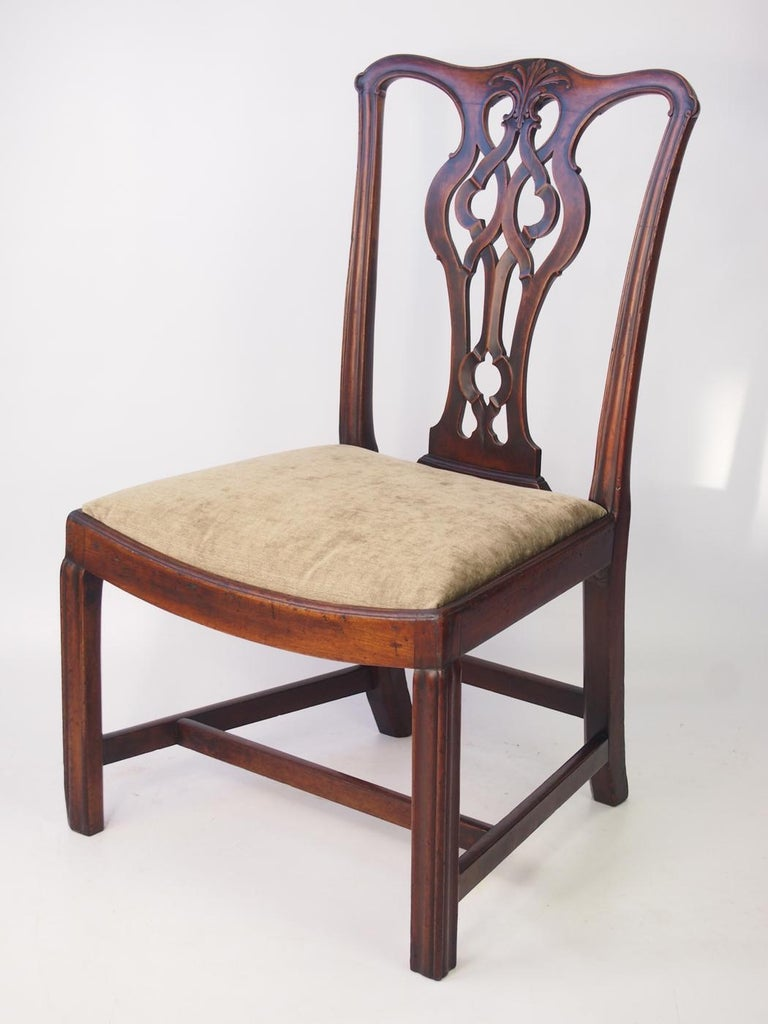 A handsome antique Georgian mahogany chair in a design influenced by Thomas Chippendale. Beautiful crisp carving, excellent colour, the best quality mahogany, dating from the late 18th century. There is an old mend to the back splat, which is solid.