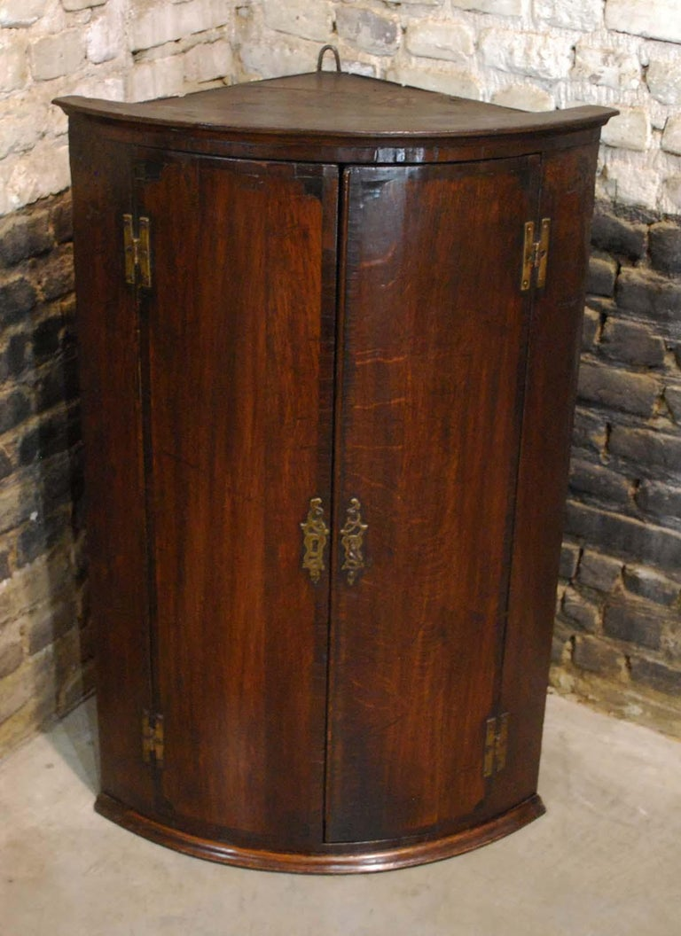 George III Antique English Georgian Oak Hanging Bowfront Corner Cabinet For Sale