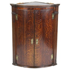 Antique English Georgian Oak and Mahogany Bow Front Corner Cupboard, circa 1790