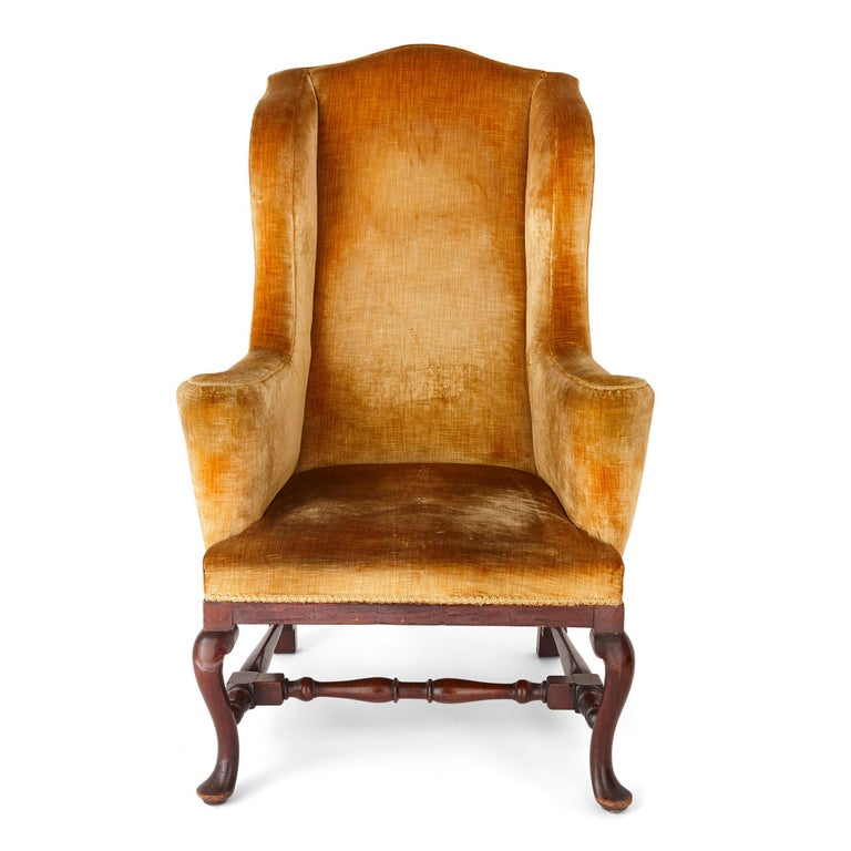 Antique English Georgian wingback chair English, early 19th century Dimensions: Height 124cm, width 79cm, depth 73cm  Crafted in traditional wingback form, this beautiful Georgian period armchair features finely carved cabriole legs, with a