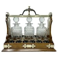 Antique English Golden Oak 3 Bottle Tantalus with 12 Cordial Glasses, Circa 1880