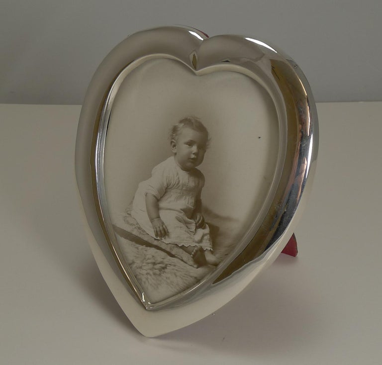 A wonderfully romantic heart shaped photograph frame to showcase your treasured picture.  This heart shaped frame is made from English sterling silver fully hallmarked for Birmingham 1901, late Victorian / early Edwardian in era. The makers