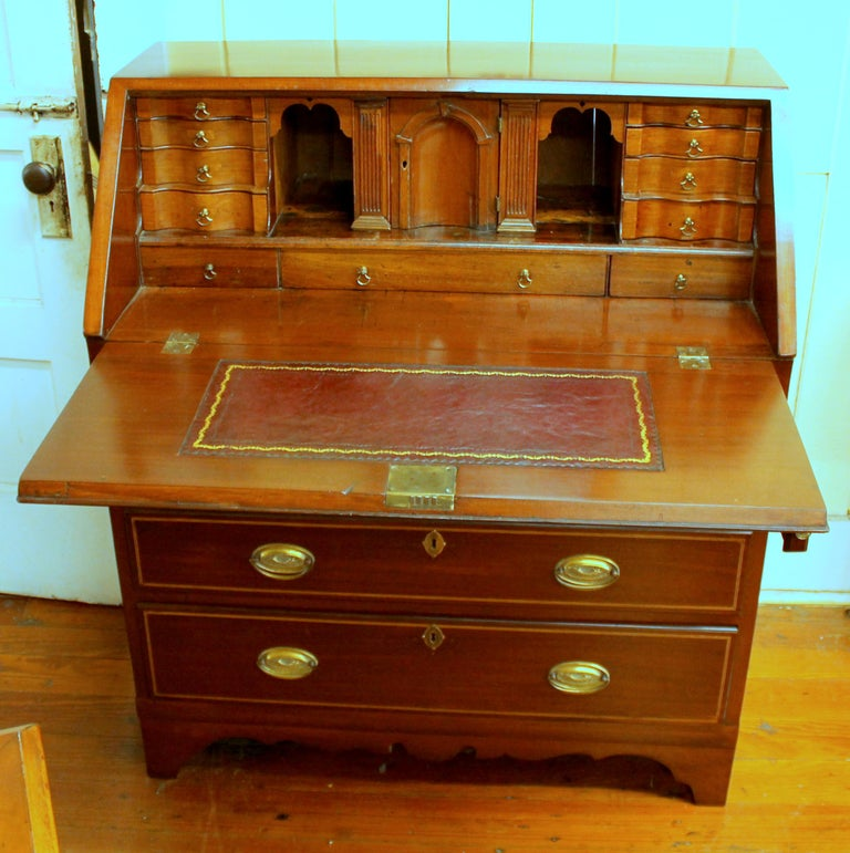 Fabulous antique English inlaid mahogany George III Slant-front Bureau with superb fitted interior. Please note the reeded columns to either side of the prospect door slide out to reveal