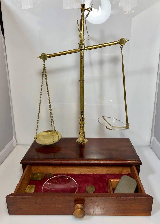 Antique English mahogany and brass apothecary scale signed R. Avery Company, London, circa 1880.