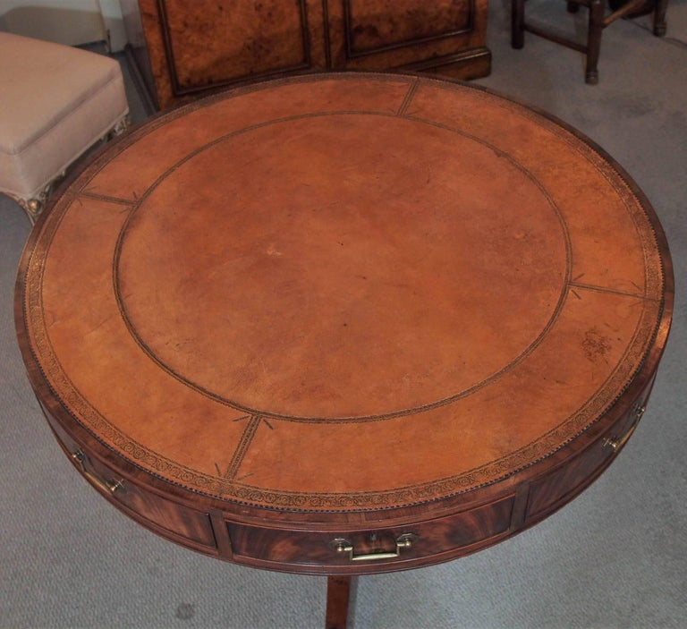 Antique English mahogany leather top rent table.