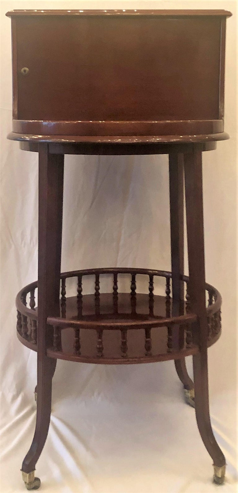 Antique English Mahogany Revolving Hidden Bar by