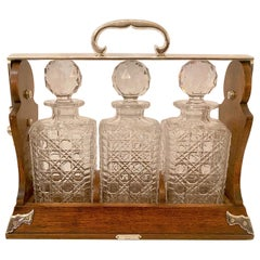 "Antique English Oak and Silver 3 Bottle Crystal Tantalus, ""Betjemann"" circa 1860"