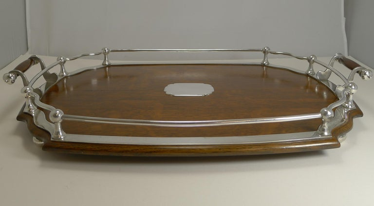 A most handsome late Victorian / early Edwardian cocktail / serving tray, creates a great look for your drinks display paired together with other complimentary pieces (these are not included).  Made from a solid English oak and standing on four
