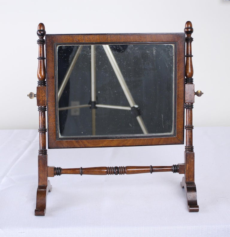 Charming look, lovely oak with good patina. Adjustable. Wood backing protects the original mirror, which has some distress as would be expected.