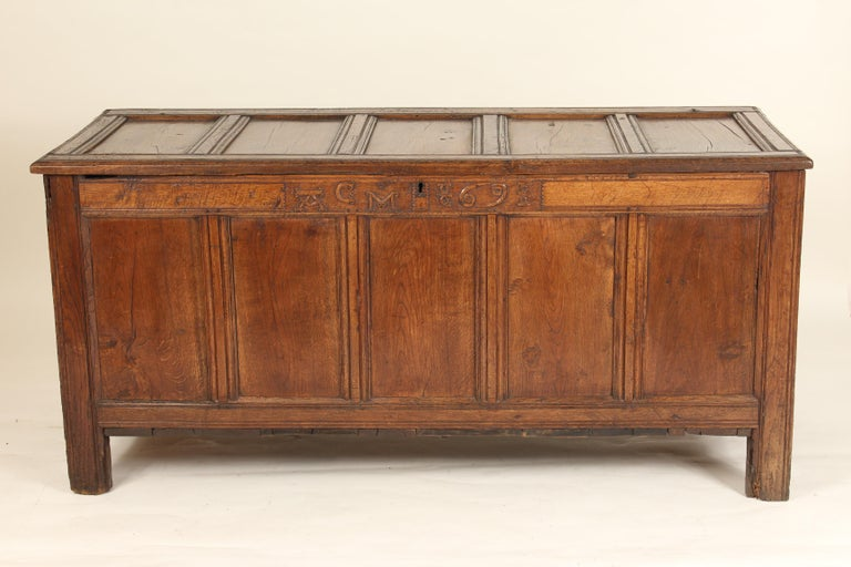 Large scale antique English oak trunk, 18th century. With carved initials and date numbers CM and 69 for 1769.