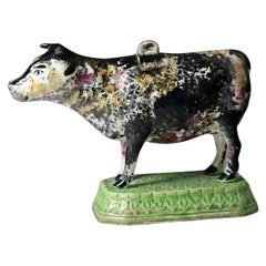 Antique English Pottery Cow Creamer Standing on Green Base, Early 19th Century