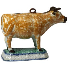 Antique English Pottery Figure of a Cow Creamer in Prattware, circa 1800