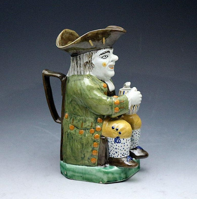 Antique English prattware pottery toby jug early 19th century. England, circa 1810.