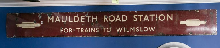 Vintage porcelain enameled, painted sign from the Mauldeth railway station which opened in 1909. This station serves the Ladybarn area of Manchester, England. When the rail line was electrified in the 1960s after using coal fired steam engines for