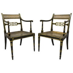 Antique English Regency Black and Gold Ebonized Cane Armchairs, a Pair
