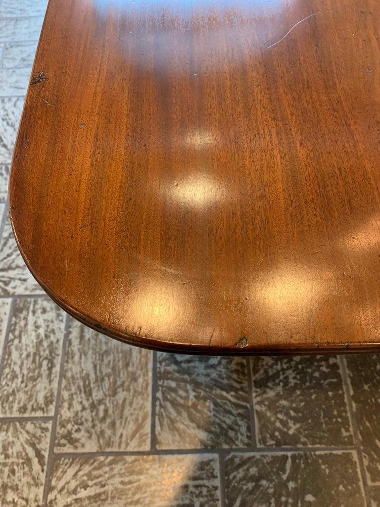 Antique English Regency mahogany dining table.