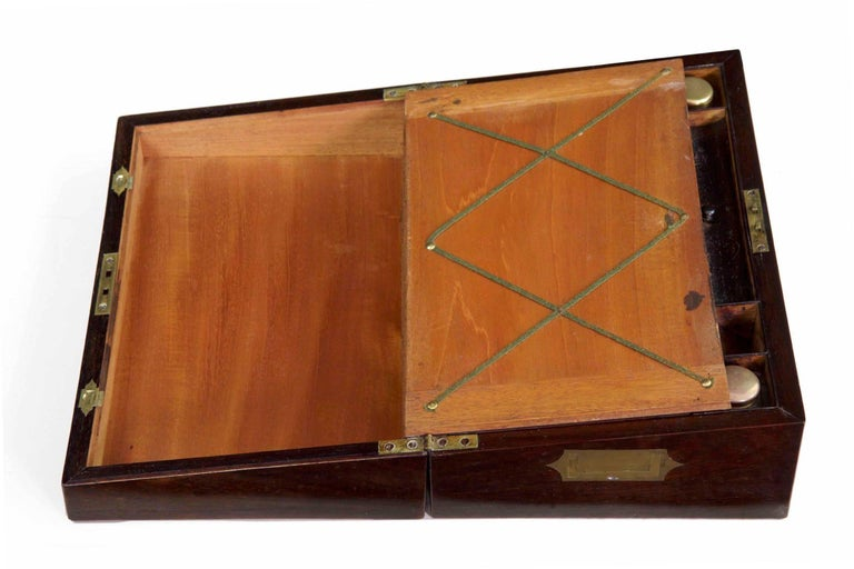 A very nice quality English Regency period rosewood and brass writing slope, this is a Fine piece remaining in excellent original condition. It opens to reveal an early tooled green leather writing surface with a locking upper that opens to reveal a