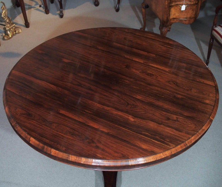 19th century English Regency rosewood centre table on pedestal base.