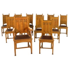 Antique English Set of 12 Gothic Revival Arts & Crafts Oak Dining Chairs