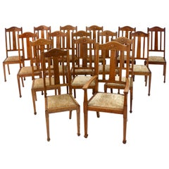 Antique English Set of 16 Arts & Crafts Oak Dining Chairs by Shapland & Petter