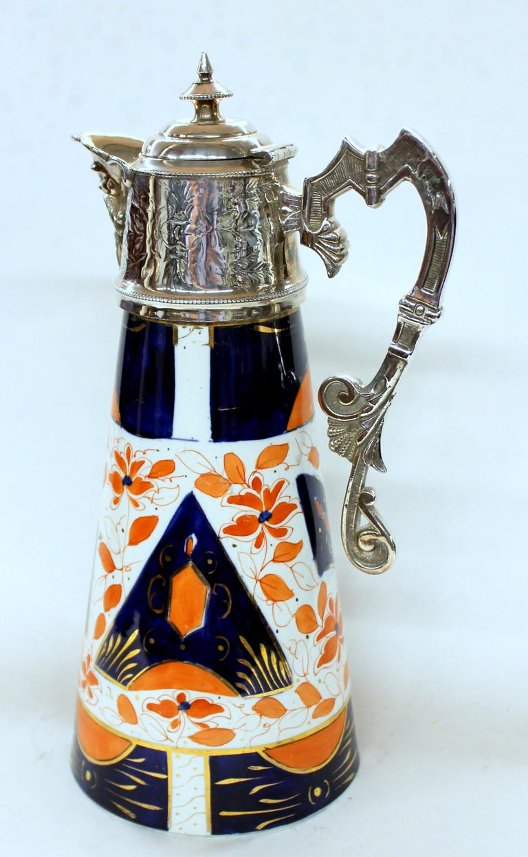 Exceedingly rare and fine antique English silver plate and Imari decorated porcelain claret jug.