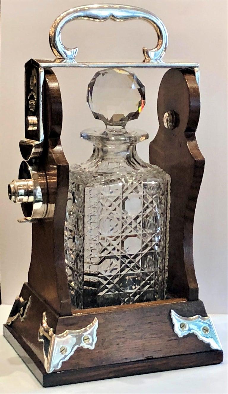 Antique English silver plated single bottle Tantalus, circa 1880-1890.