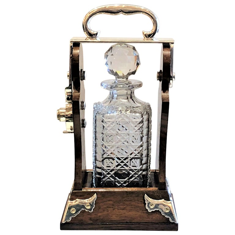 Antique English Silver Plated Single Bottle Tantalus, circa 1880-1890 For Sale