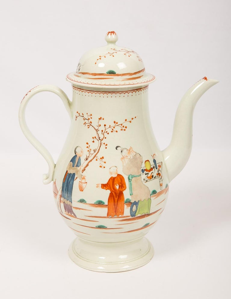 We are pleased to offer this rare Liverpool soft-paste porcelain coffee pot made in England in the late 18th century, circa 1785. The pot is painted with a lovely chinoiserie scene on both sides of the body. In the scene, a lady stands in front of a