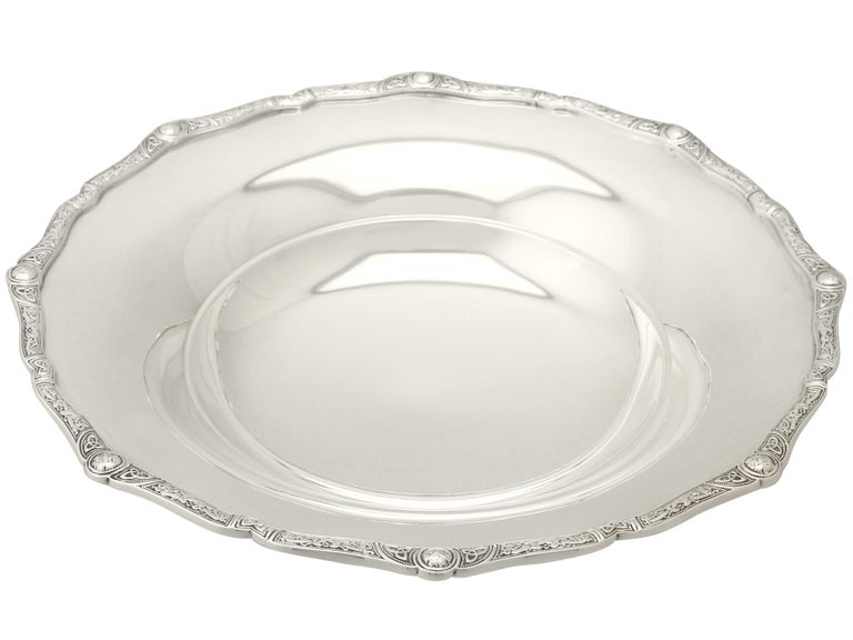 An exceptional, fine and impressive antique George V English sterling silver dish or tazza in the Lindisfarne style; an addition to our ornamental silverware collection.  This exceptional antique George V sterling silver dish or tazza has a