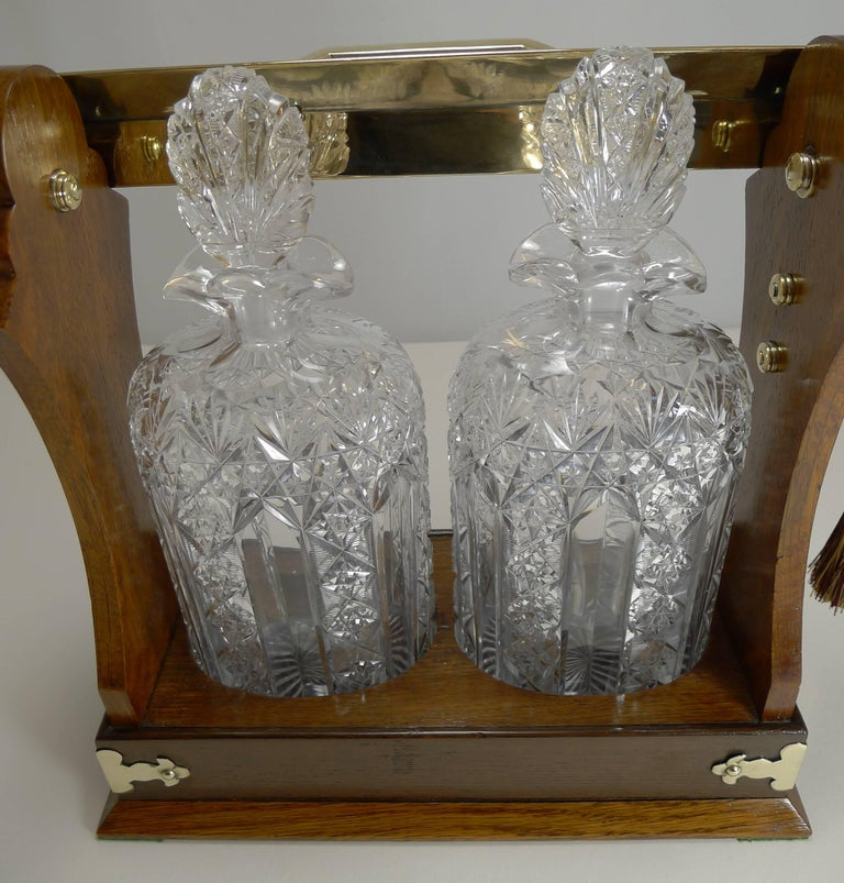 19th Century Antique English Tantalus Exceptional Cut Crystal Oval Decanters, circa 1890 For Sale
