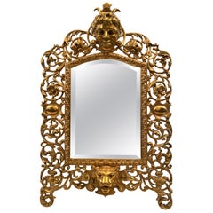 Antique English Victorian Cast Brass Ornately Framed Beveled Mirror, circa 1880